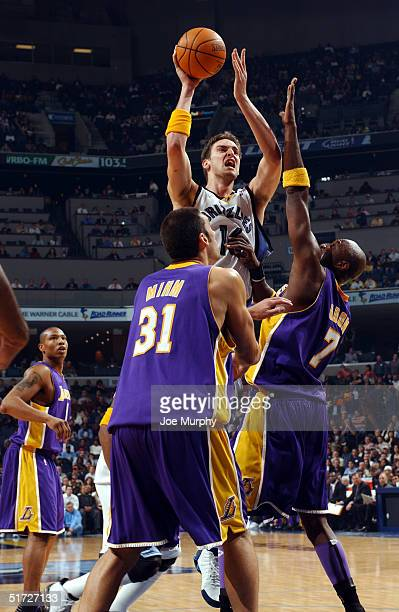 Pau Gasol of the Memphis Grizzlies puts up a shot over the defense of Lamar Odom of the Los Angeles Lakers during a game at Fedex Forum on November...