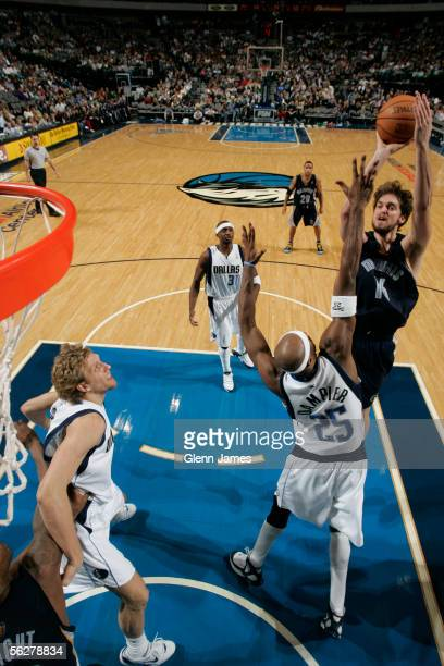 Pau Gasol of the Memphis Grizzlies shoots a jumper over Erick Dampier against the Dallas Mavericks on November 26 2005 at American Airlines Center in...