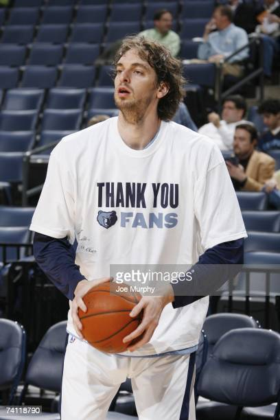 Pau Gasol of the Memphis Grizzlies warms up wearing a 'thank you' shirt before the NBA game against the San Antonio Spurs on April 16 2007 at...