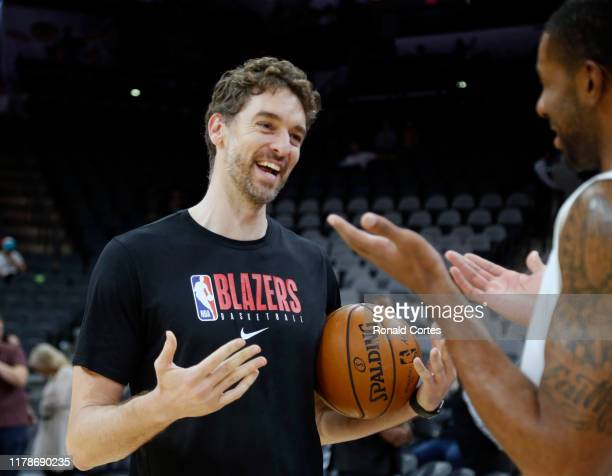 Pau Gasol of the Portland Trailblazers greets LaMarcus Aldridge of the San Antonio Spurs before the start of their game at AT&T Center on October 28,...