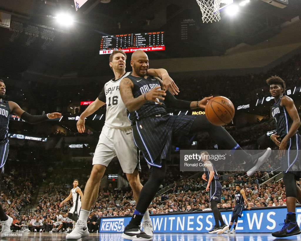 Pau Gasol #16 of the San Antonio Spurs and Marreese Speights #5 of the Orlando Magic fight for a rebound at AT&T Center on March 13, 2018 in San Antonio, Texas.