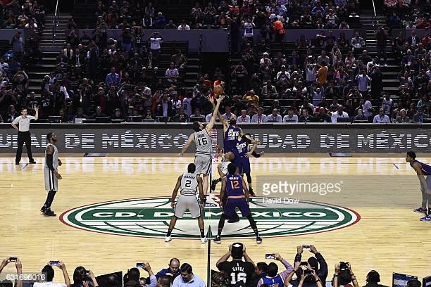 Pau Gasol of the San Antonio Spurs and Tyson Chandler of the Phoenix Suns go up for the opening tip off as part of NBA Global Games at Arena Ciudad...
