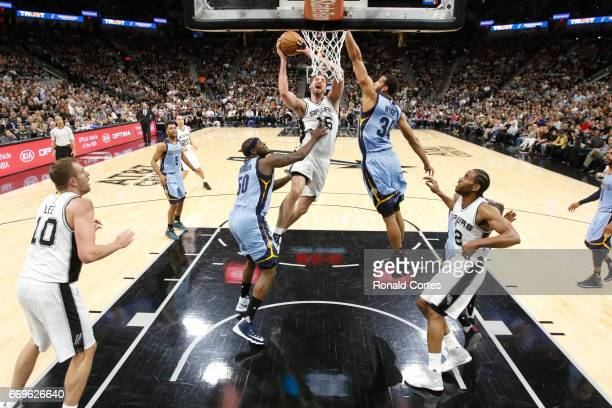 Pau Gasol of the San Antonio Spurs drives past Brandan Wright of the Memphis Grizzlies and Zach Randolph of the Memphis Grizzlies in Game Two of the...
