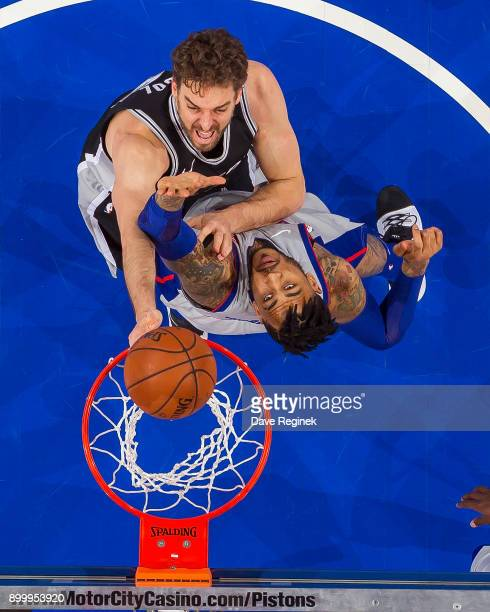 Pau Gasol of the San Antonio Spurs drives to the basket on Eric Moreland of the Detroit Pistons during an NBA game at Little Caesars Arena on...