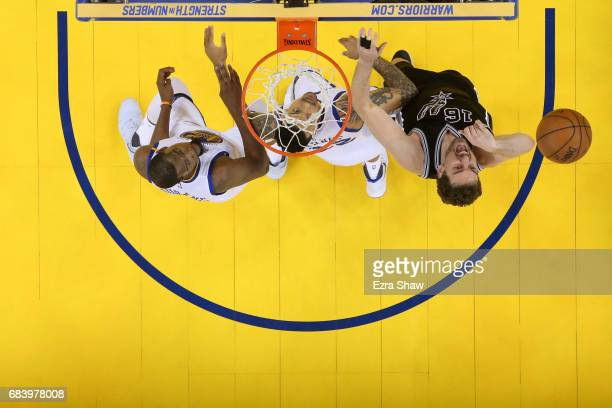 Pau Gasol of the San Antonio Spurs fights for position with Matt Barnes and Kevin Durant of the Golden State Warriors during Game Two of the NBA...