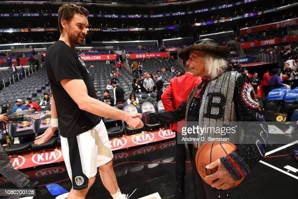 Pau Gasol of the San Antonio Spurs greets James Goldstein before the game against the LA Clippers on December 29 2018 at STAPLES Center in Los...