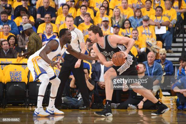 Pau Gasol of the San Antonio Spurs handles the ball against Draymond Green of the Golden State Warriors during Game Two of the Western Conference...