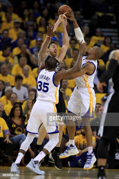 Pau Gasol of the San Antonio Spurs has his pass blocked by David West of the Golden State Warriors during Game Two of the NBA Western Conference...