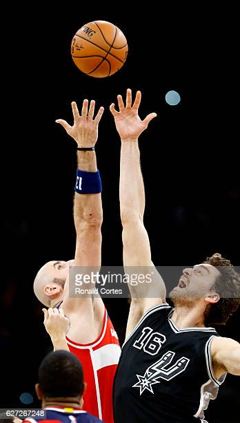 Pau Gasol of the San Antonio Spurs jumps against Marcin Gortat of the Washington Wizards at AT&T Center on December 2, 2016 in San Antonio, Texas....