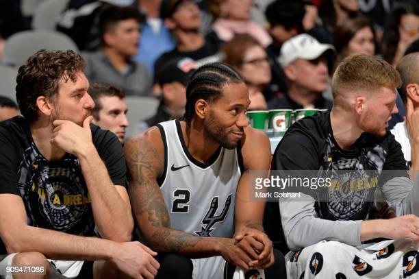 Pau Gasol of the San Antonio Spurs Kawhi Leonard of the San Antonio Spurs and Davis Bertans of the San Antonio Spurs look on against the Denver...