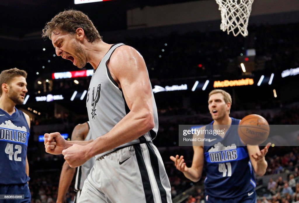 Pau Gasol #16 of the San Antonio Spurs reacts after a basket and a foul by Dirk Nowitzki #41 of the Dallas Mavericks at AT&T Center on November 27, 2017 in San Antonio, Texas.