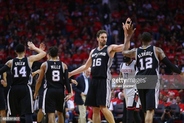 Pau Gasol of the San Antonio Spurs reacts with Danny Green Patty Mills and LaMarcus Aldridge against the Houston Rockets during Game Six of the NBA...