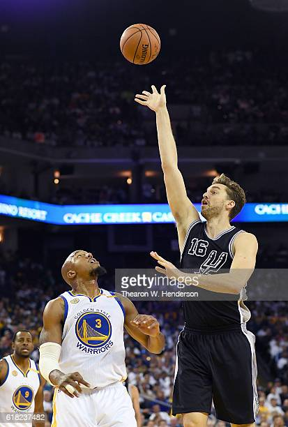 Pau Gasol of the San Antonio Spurs shoots over David West of the Golden State Warriors during the third quarter in an NBA basketball game at ORACLE...