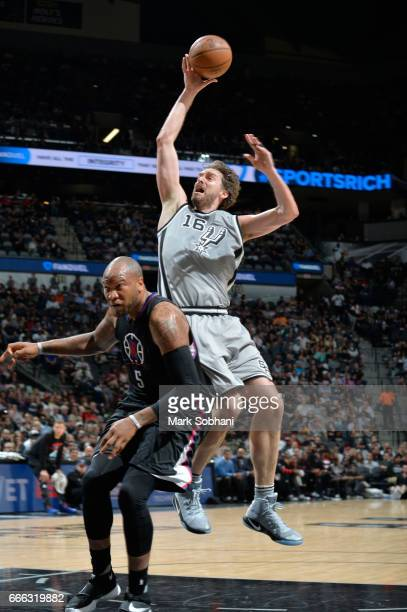 Pau Gasol of the San Antonio Spurs shoots the ball against Marreese Speights of the LA Clippers during the game on April 8 2017 at the ATT Center in...