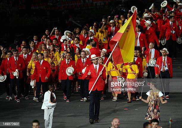 Pau Gasol of the Spain Olympic basketball team carries his country's flag during the Opening Ceremony of the London 2012 Olympic Games at the Olympic...