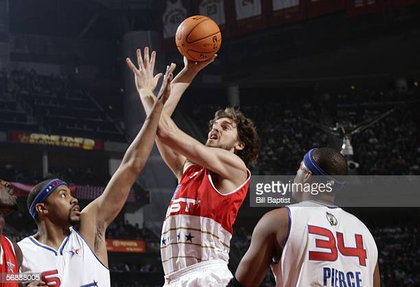 Pau Gasol of the Western Conference attempts a shot against Rasheed Wallace and Paul Pierce of the Eastern Conference during the 2006 NBA AllStar...