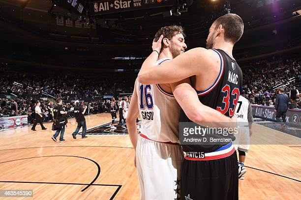 Pau Gasol of the Western Conference hugs his brother Marc Gasol of the Western Conference after the 64th NBA AllStar Game presented by KIA as part of...
