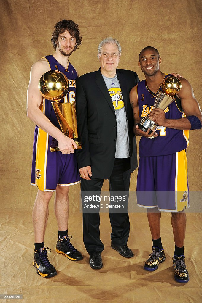 Pau Gasol #16, Phil Jackson and Kobe Bryant #24 of the Los Angeles Lakers pose for a portrait after defeating the Orlando Magic in Game Five of the 2009 NBA Finals at Amway Arena on June 14, 2009 in Orlando, Florida. The Los Angeles Lakers defeated the Orlando Magic 99-86.