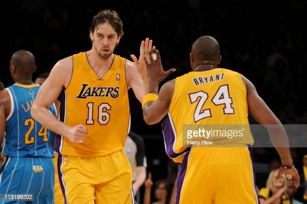 Pau Gasol reacts with teammate Kobe Bryant of the Los Angeles Lakers in the third quarter while taking on the New Orleans Hornets in Game Five of the...