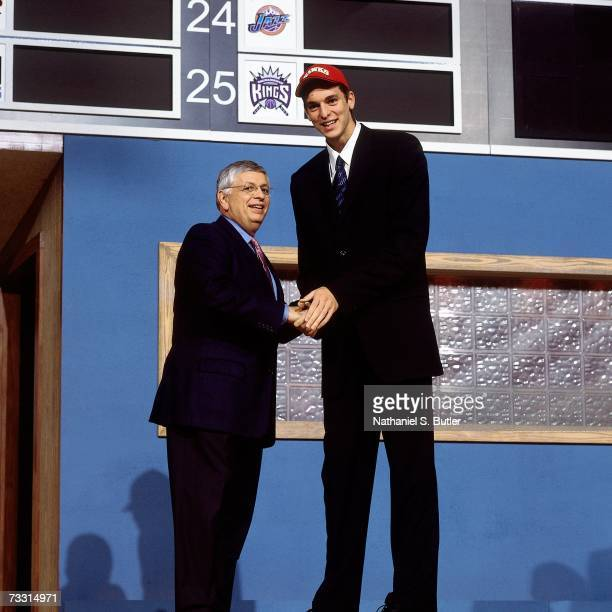 Pau Gasol shakes hands with NBA Commissioner David Stern after he was selected by the Atlanta Hawks during the 2001 NBA Draft at the Paramount...