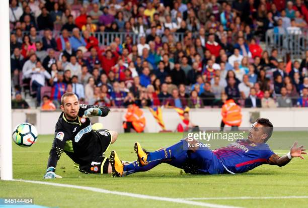Pau Lopez and Paulinho Bezerra during La Liga match between FC Barcelona v RCD Espanyol in Barcelona on September 09 2017