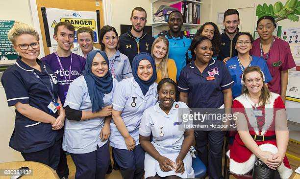 Pau Lopez Moussa Sissoko Leah Rawle and Hugo Lloris of Tottenham Hotspur pose for a photograph with hospital staff after handing out presents to...