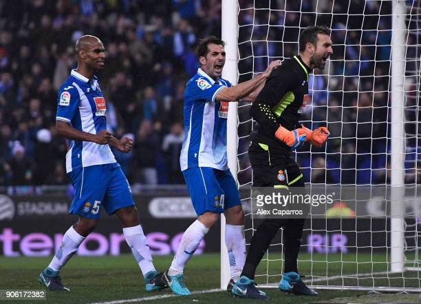 Pau Lopez of Espanyol celebrates with team mates after saving a penalty during the Spanish Copa del Rey Quarter Final First Leg match between...