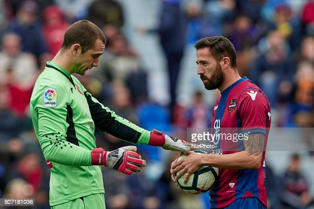 Pau Lopez of RCD Espanyol touches the ball next to Morales of Levante UD during the La Liga match between Levante UD and RCD Espanyol at Ciutat de...