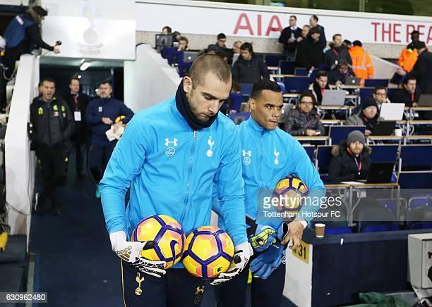 Pau Lopez of Tottenham Hotspur and Michel Vorm of Tottenham Hotspur walk out to warm up prior to the Premier League match between Tottenham Hotspur...