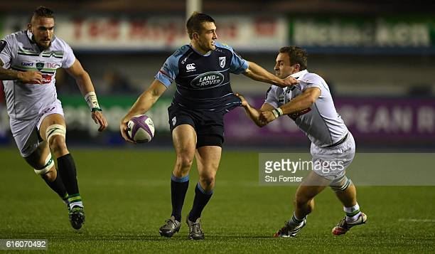 Pau player Pierre Dupouy is unable to halt the charge of Blues centre Garyn Smith during the European Rugby Challenge Cup match between Cardiff Blues...