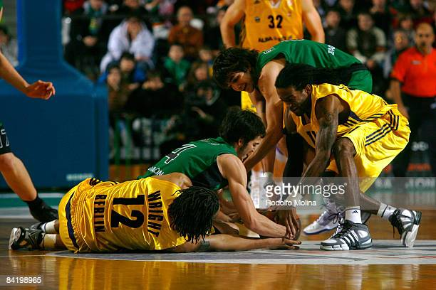 Pau Ribas #4 of DKV Joventut and Ricky Rubio #9 competes with Rashad Wright #12 of Alba Berlin and Julios Jenkins #11 during the Euroleague...