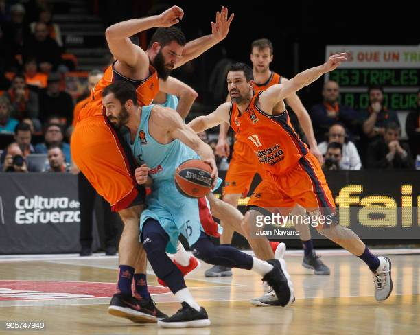 Pau Ribas #5 of FC Barcelona Lassa competes with Bojan Dubljevic #14 of Valencia Basket during the 2017/2018 Turkish Airlines EuroLeague Regular...
