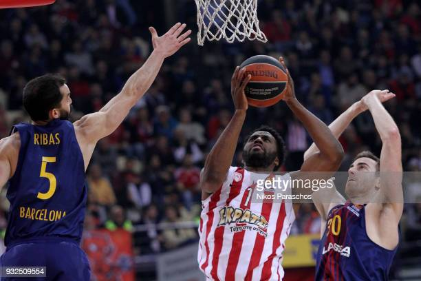Pau Ribas #5 of FC Barcelona Lassa competes with Jamel McLean #1 of Olympiacos Piraeus during the 2017/2018 Turkish Airlines EuroLeague Regular...