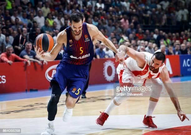 Pau Ribas of Barcelona is challenged by Branko Lazic of Crvena Zvezda during the 2017/2018 Turkish Airlines EuroLeague Regular Season game between...
