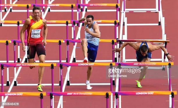 Pau Tonnesen of Spain, Ashley Bryant of Great Britain and Mihail Dudas of Serbia compete in the Men's Decathlon 110 metres hurdles during day nine of...