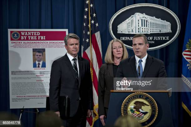 Paul Abbate executive assistant director of the Federal Bureau of Investigation criminal cyber response and services branch right speaks as Mary...