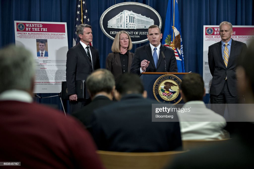 Paul Abbate, executive assistant director of the Federal Bureau of Investigation (FBI) criminal, cyber, response and services branch, center, speaks as Brian Stretch, U.S. attorney for the northern district of California, from left, Mary McCord, acting U.S. assistant attorney general for national security, and Vaughn Ary, director of the Justice Departments office of international affairs, listen during a news conference at the Department of Justice in Washington, D.C., U.S., on Wednesday, March 15, 2017. The U.S. charged four people, including two Russian intelligence officers, over the theft of hundreds of millions of accounts of Yahoo Inc. users from a computer breach that threatened to derail its acquisition by Verizon Communications Inc. Photographer: Andrew Harrer/Bloomberg via Getty Images