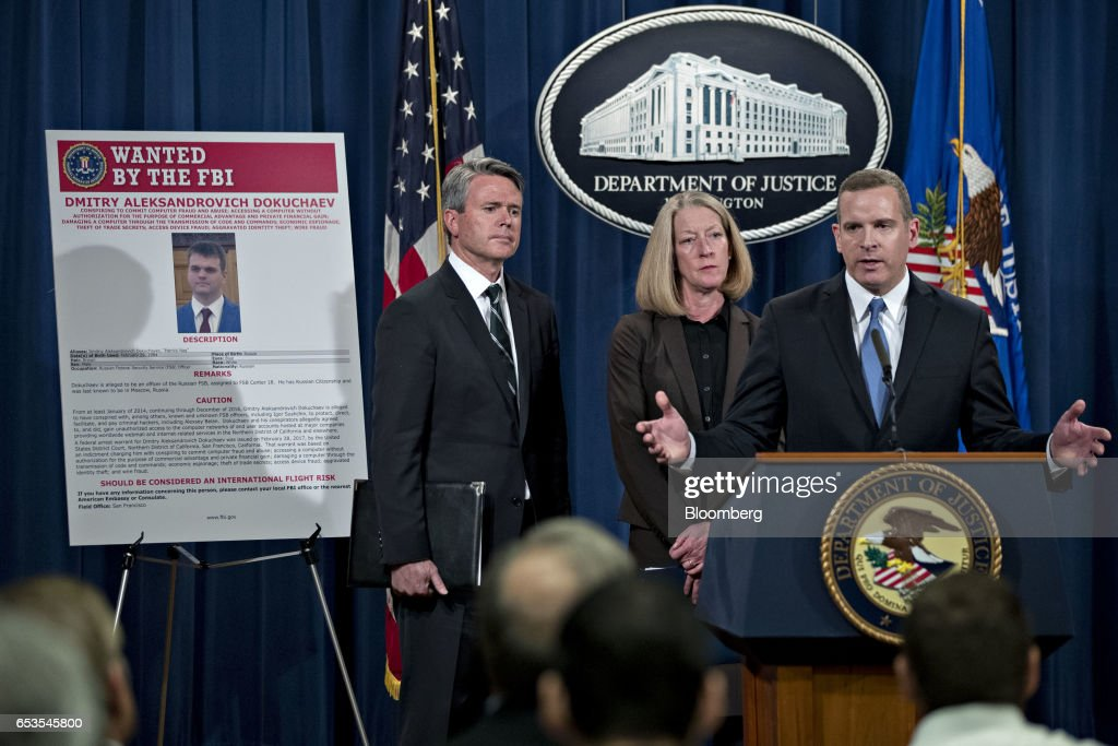 Paul Abbate, executive assistant director of the Federal Bureau of Investigation (FBI) criminal, cyber, response and services branch, right, speaks as Mary McCord, acting U.S. assistant attorney general for national security, center, and Brian Stretch, U.S. attorney for the northern district of California, listen during a news conference at the Department of Justice in Washington, D.C., U.S., on Wednesday, March 15, 2017. The U.S. charged four people, including two Russian intelligence officers, over the theft of hundreds of millions of accounts of Yahoo Inc. users from a computer breach that threatened to derail its acquisition by Verizon Communications Inc. Photographer: Andrew Harrer/Bloomberg via Getty Images