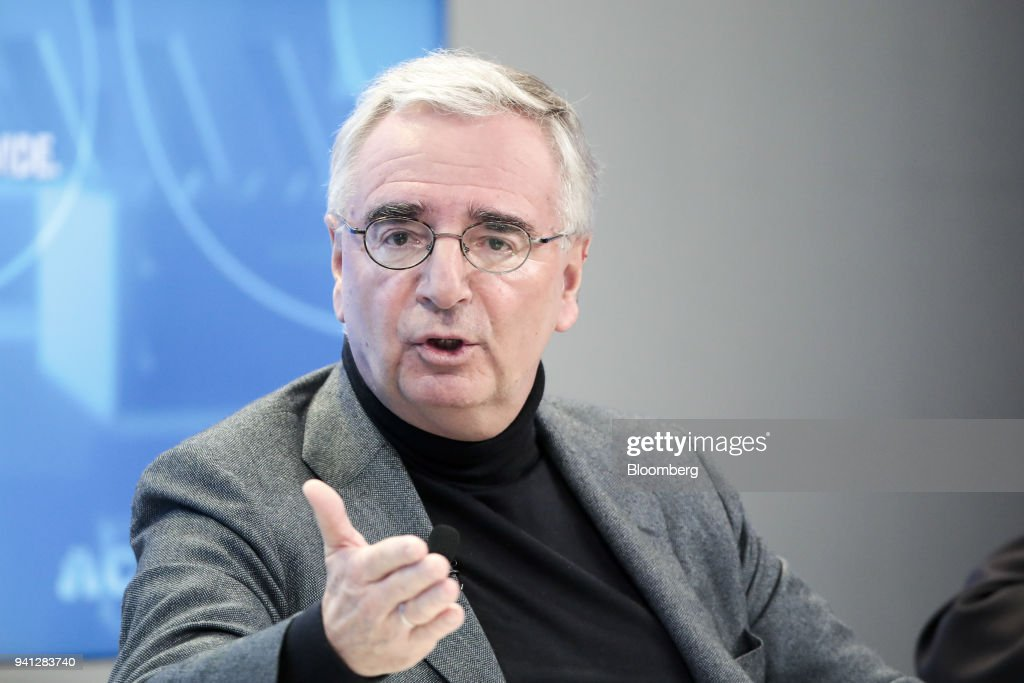 Paul Achleitner, chairman of Deutsche Bank AG, gestures as he speaks during a panel session on day three of the World Economic Forum (WEF) in Davos, Switzerland, on Thursday, Jan. 25, 2018. Deutsche Bank AG is considering candidates to potentially replace Chief Executive Officer John Cryan amid heightened tensions between him and Supervisory Board Chairman Achleitner, the Times of London reported without saying where it got the information. The bank approached Richard Gnodde, the head of Goldman Sachs Group Inc.s international operations, but hes thought to have spurned the overture, the newspaper said. Deutsche Bank also considered UniCredit SpA CEO Jean Pierre Mustier and Standard Chartered Plc CEO Bill Winters, according to the report. Our editors select the best archive images for the Deutsche story. Photographer: Jason Alden/Bloomberg via Getty Images