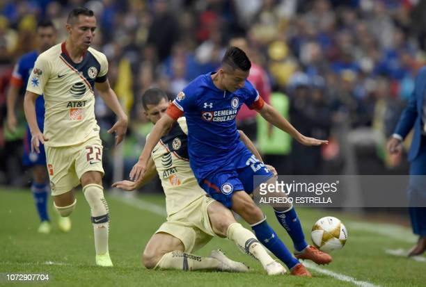 Paul Aguilar and Guido Rodriguez of America vies for the ball with Carlos Alvarado of Cruz Azul during the first round of final of the Mexican...