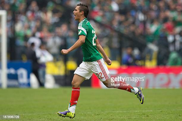 Paul Aguilar celebrates a scored goal against New Zealand during a match between Mexico and New Zealand as part of the FIFA World Cup Qualifiers at...