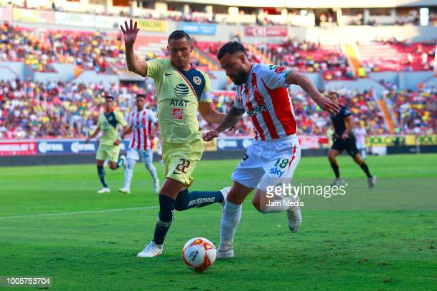 Brayan Beckeles of Necaxa fights for the ball with Andres Ibargüen of America during the 1st round match between Necaxa and America as part of the...