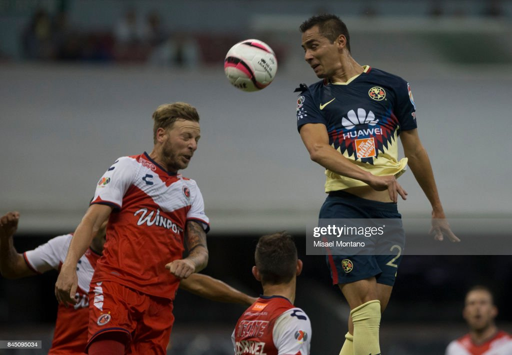 Paul Aguilar of America heads for the ball with Cristian Menendez of Veracruz during the 8th round match between America and Veracruz as part of the Torneo Apertura 2017 Liga MX at Azteca Stadium on September 09, 2017 in Mexico City, Mexico.