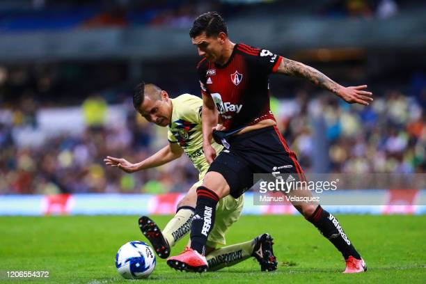 Paul Aguilar of America struggles for the ball against Edgar Zaldivar of Atlas during the 6th round match between America and Atlas as part of the...