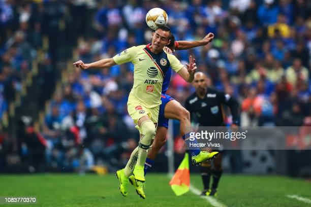 Paul Aguilar of America struggles for the ball with Adrian Aldrete of Cruz Azul during the final second leg match between Cruz Azul and America as...