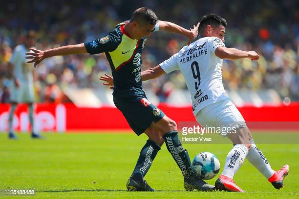 Paul Aguilar of America struggles for the ball with Felipe Mora of Pumas during the seventh round match between Pumas UNAM and America as part of the...