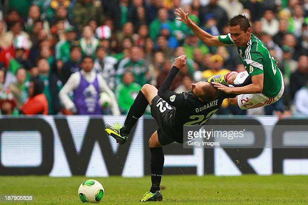 Paul Aguilar of Mexico struggles for the ball with Andrew Durante of New Zealand during a match between Mexico and New Zealand as part of the FIFA...
