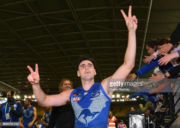 Paul Ahern of the Kangaroos celebrates winning the round 11 AFL match between the North Melbourne Kangaroos and the Brisbane Lions at Etihad Stadium...