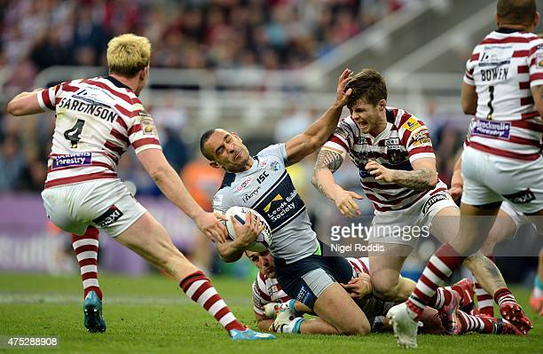Paul Aiton of Leeds Rhinos tackled by John Bateman of Wigan Warriors during the Super League match between Leeds Rhinos and Wigan Warriors at St...