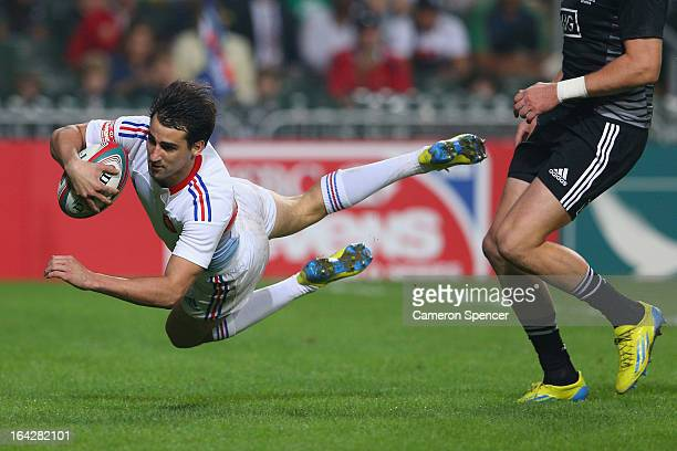 Paul Albaladejo of France scores a try during the Pool B match between France and New Zealand during day one of the 2013 Hong Kong Sevens at Hong...